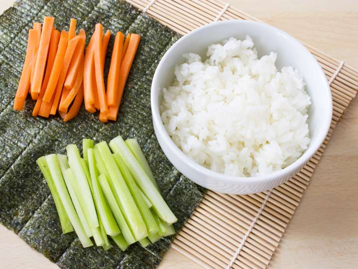 rice, carrots, cucumber, and nori for sushi