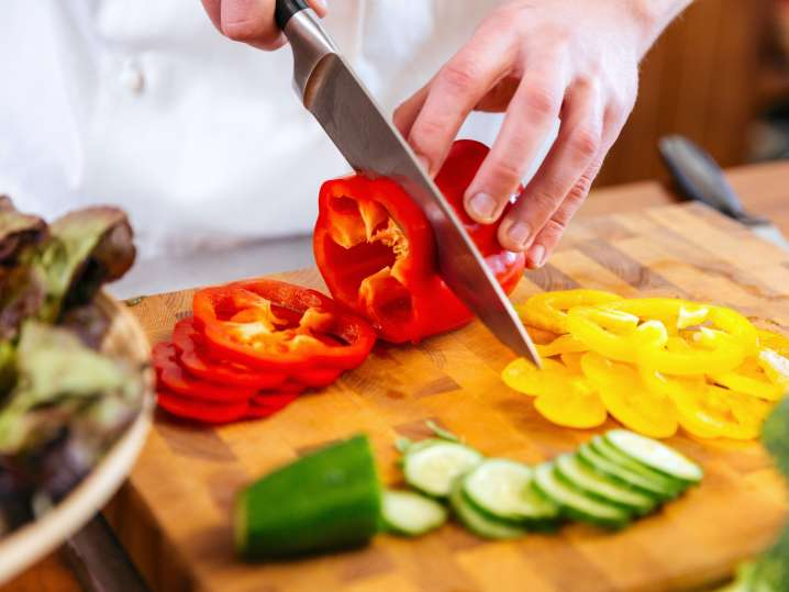 Los Angeles - chef slicing red bell peppers.jpg