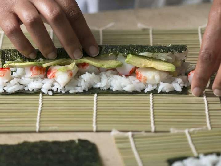 person making a california sushi roll   Classpop
