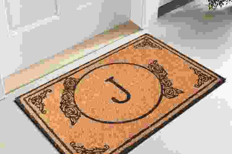 hand-woven monogrammed door mat