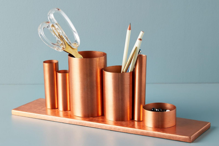 copper colored metallic pencil holder
