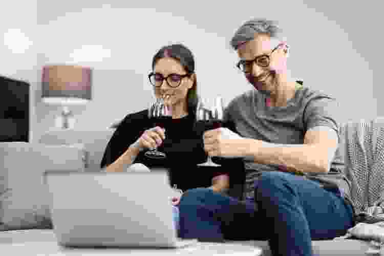 couple enjoying a virtual wine tasting at home
