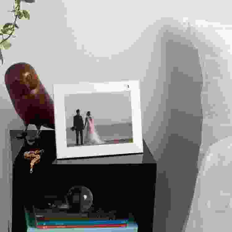 an aura digital photo frame on a side table