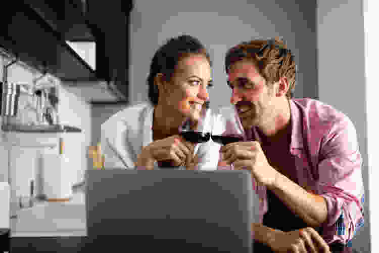couple at home taking online cooking classes and online mixology classes