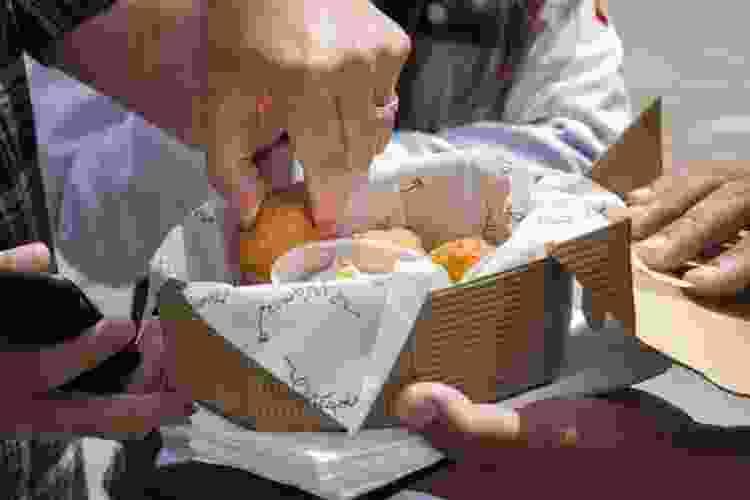 sharing food on a walking food tour