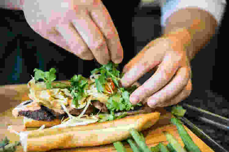 chef plating a bahn mi