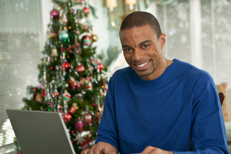 man playing virtual mad libs during a virtual christmas party