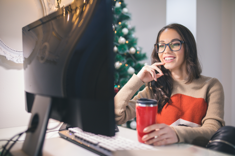 young woman playing holiday clips game with friends virtually