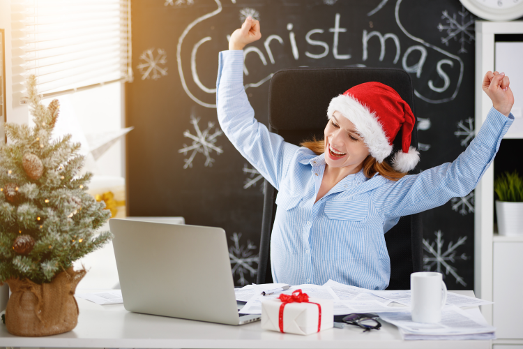 show off your decorated workspace for a fun virtual holiday party idea