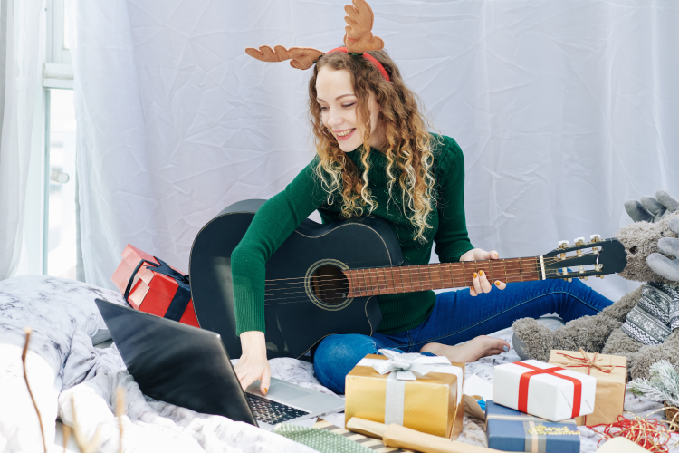 young woman dressed up in reindeer antlers for a virtual christmas party