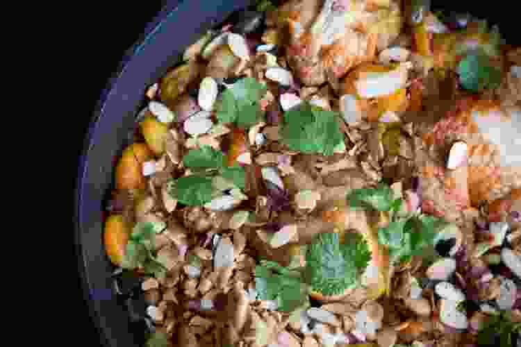 roasted chicken and almonds in a cast iron dutch oven