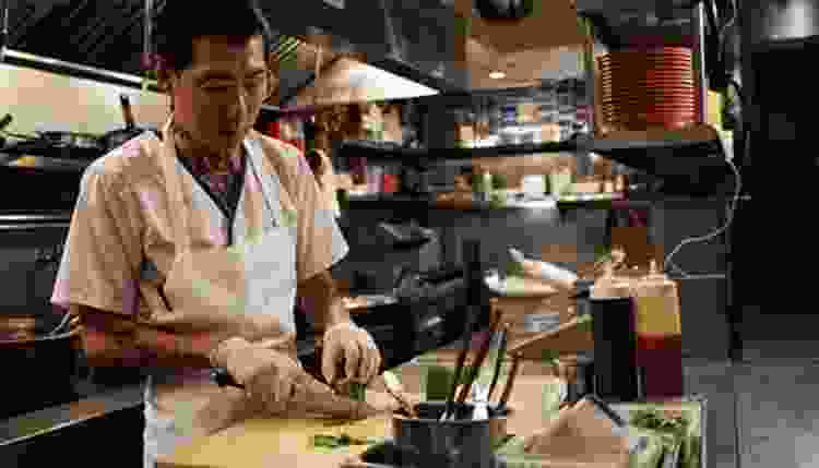 cook slicing a cucumber in the mind of a chef on netflix