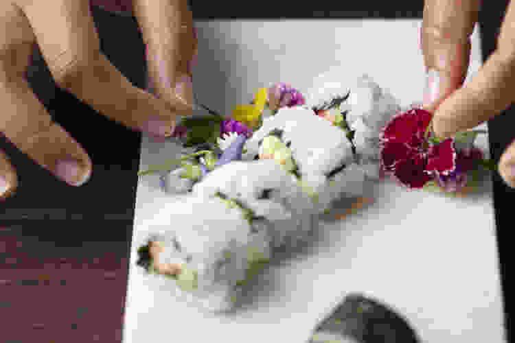 chef plating sushi rolls