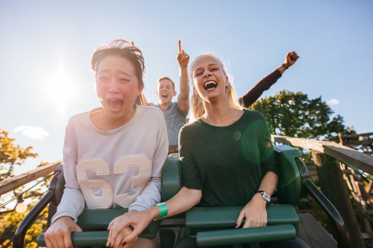 riding the roller coasters at the amusement park