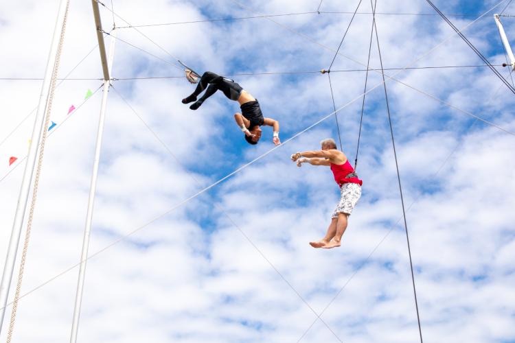 trapeze classes are unique team building activities