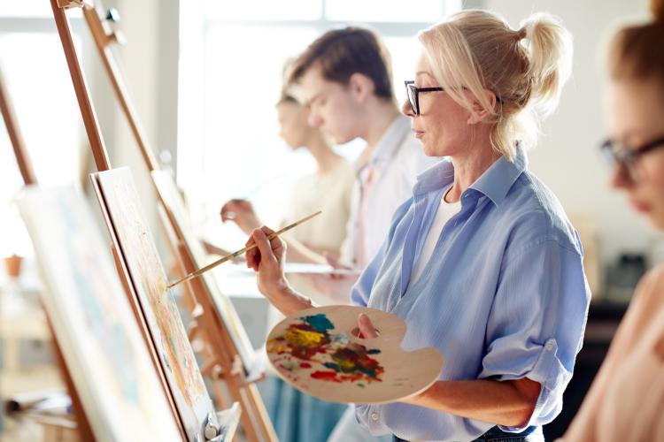 woman painting during an art class