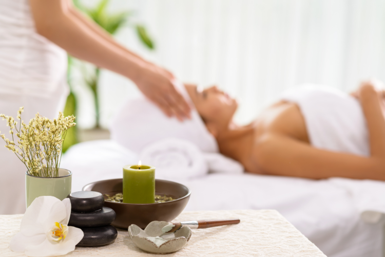 woman relaxing during a massage at a spa