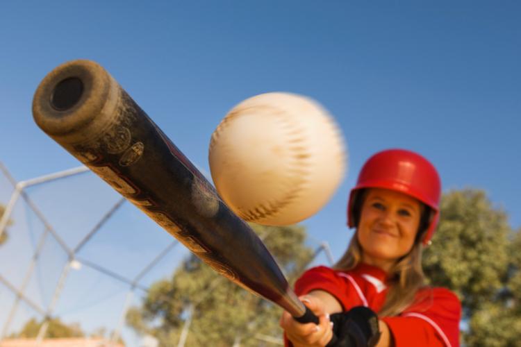 woman playing softball outside