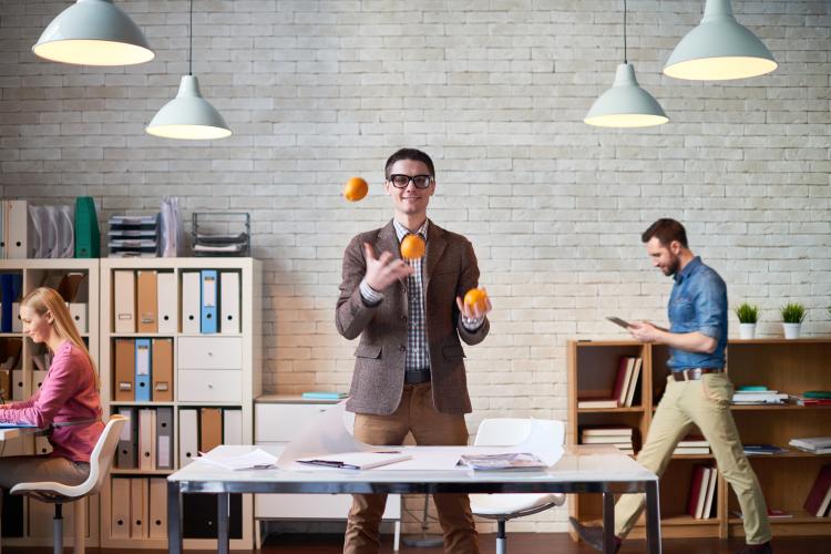 man juggling in an office