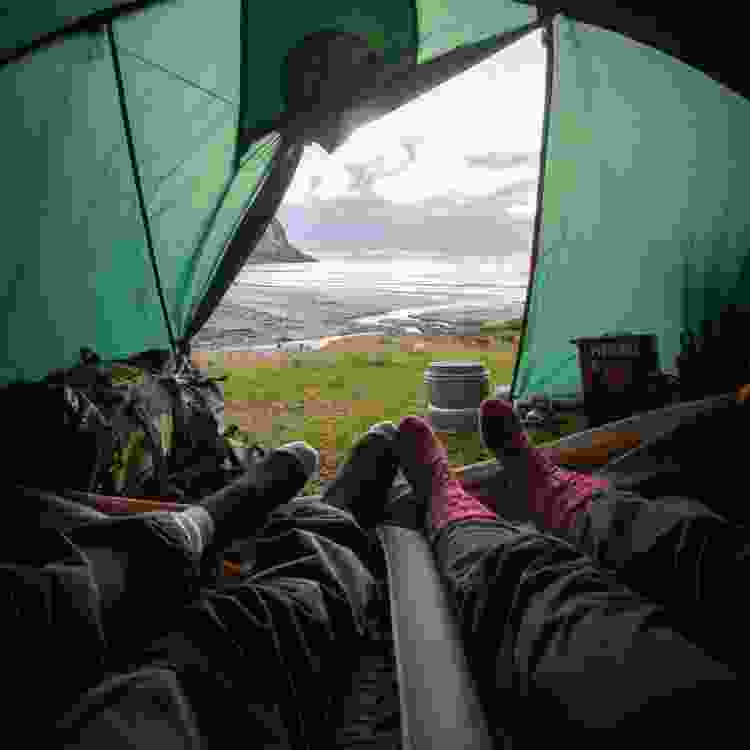 couple spending time in a tent during a weekend camping trip