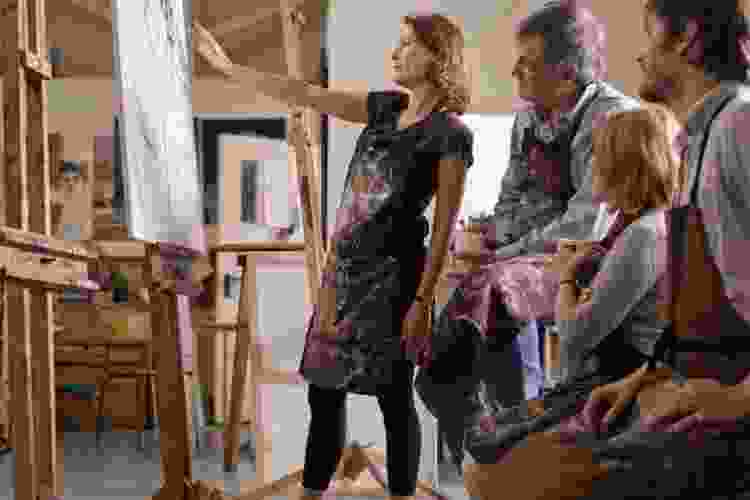 people painting during an art class