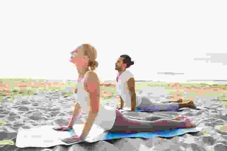beach yoga is a relaxing date idea in miami