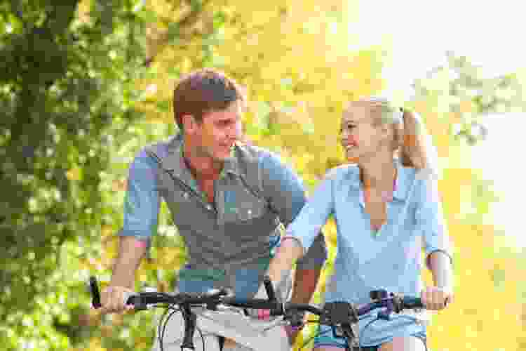 young couple taking a bike ride outdoors