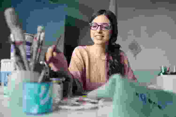 young woman painting a homemade birthday gift