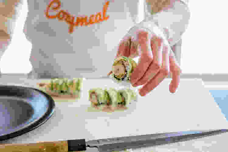 chef plating sushi during a cooking class