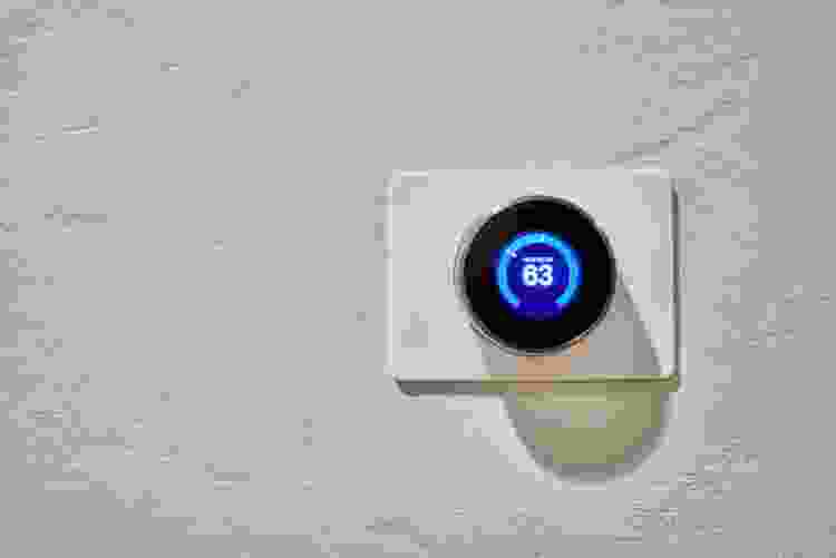 a nest thermostat on a white wall