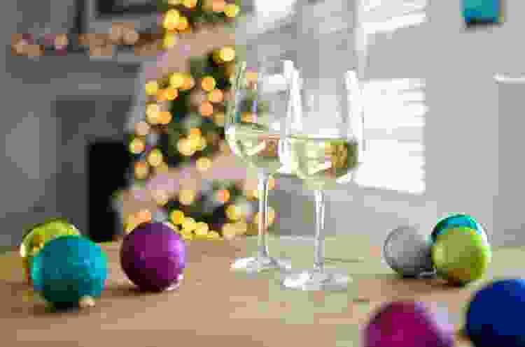 Wine glasses and christmas ornaments on a shelf