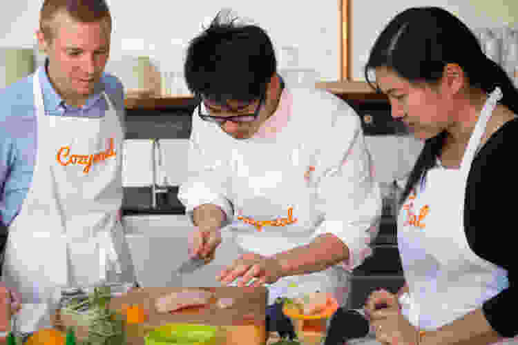 coworkers competing in a cooking team building activity