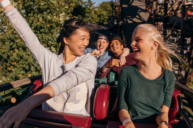 two women riding on a roller coaster