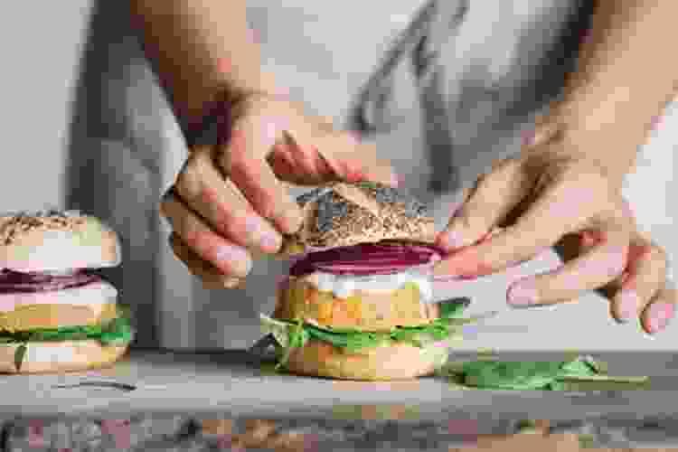 chef assembling a burger at brookfield place