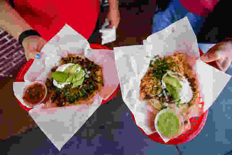 friends enjoying tacos on a san francisco food tour