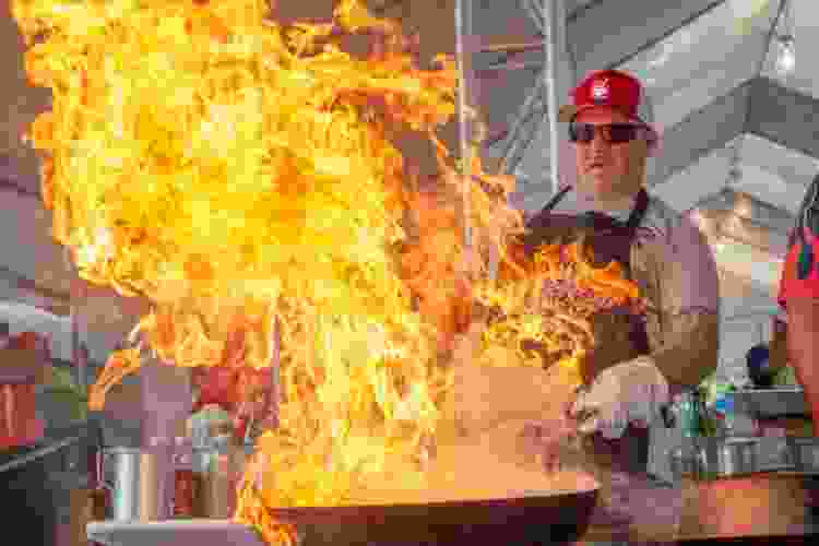 chef cooking over open flame at the gilroy garlic festival