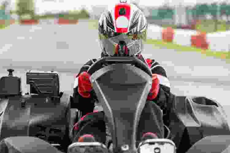go kart driver on a race track
