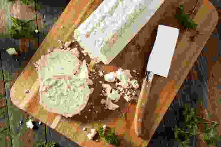 goat cheese on a wooden cutting board
