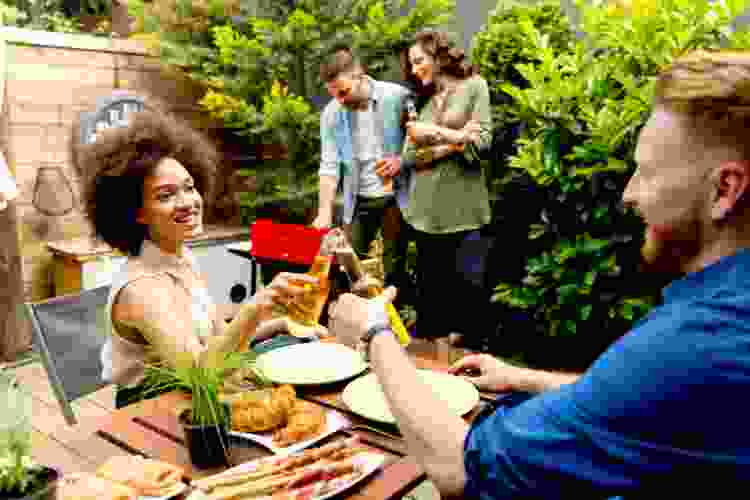 friends enjoying a double date barbecue