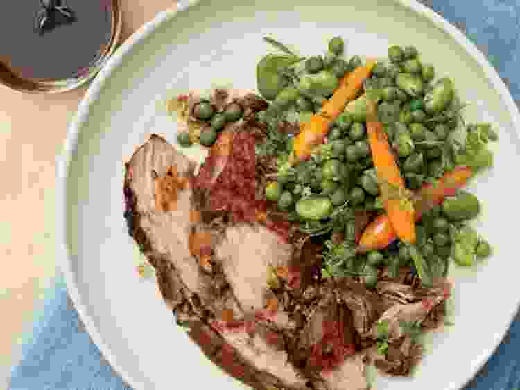 garlic rubbed pork shoulder with spring vegetables will brighten up your table