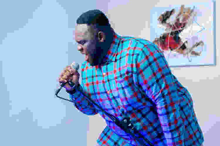 man singing into a microphone during virtual karaoke