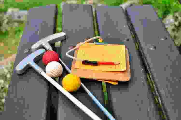 mini golf is a class date idea in denver