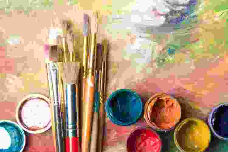 paint brushes and paints on a canvas