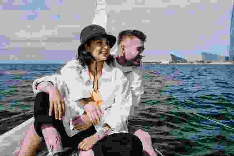 man and woman on a sightseeing boat tour