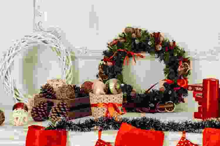 christmas wreath, ornaments and decor on a shelf