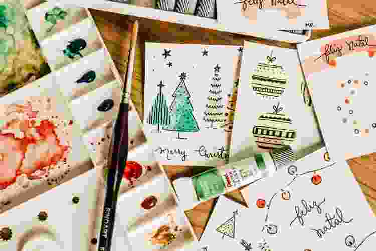painting supplies and paper for making homemade holiday cards