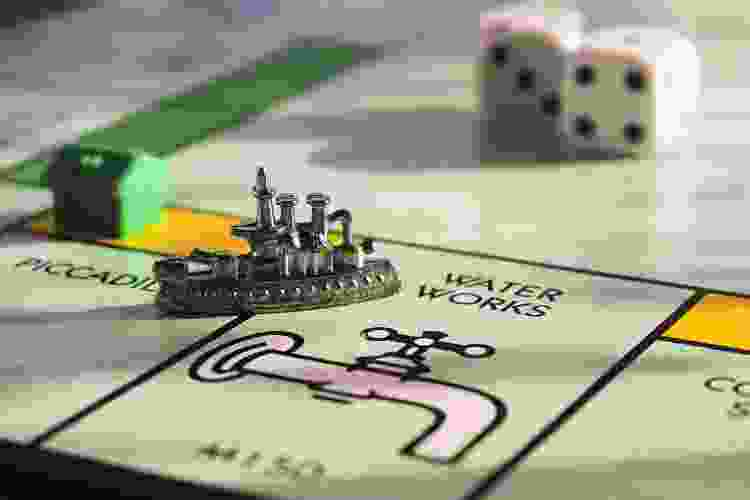 steamboat game piece on a monopoly board