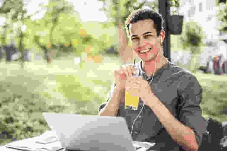 man drinking a cocktail outside during a virtual happy hour