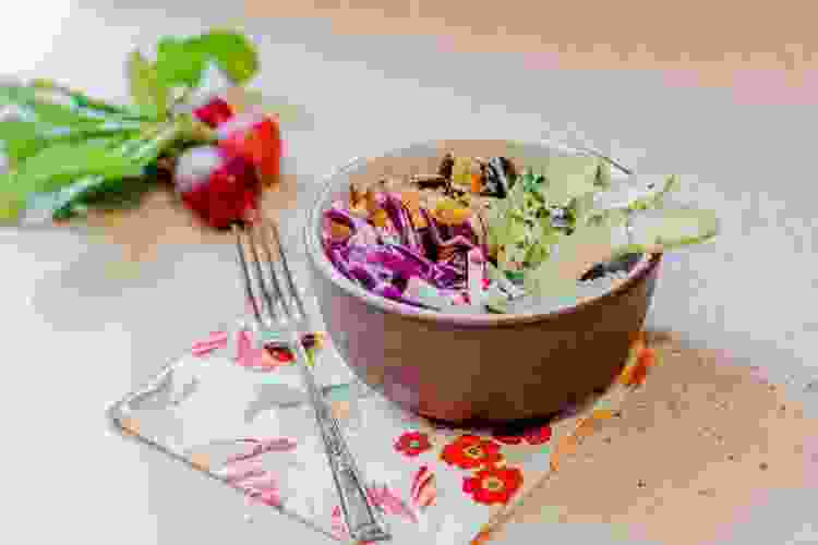 cabbage and slaw plated in a bowl