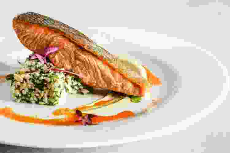 seared salmon steak over herbed couscous